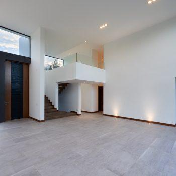 Latex spuiten van wanden en plafonds in RAL9010 afgerond project in Reuver.